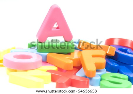 multicoloured bright plastic letters A on white background