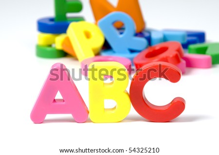 multicoloured bright plastic letters ABC on white background