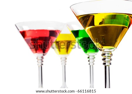 Multicoloured cocktails served in classic martini glasses