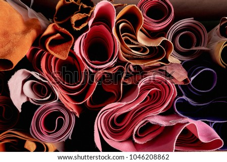 Multicoloured leather in rolls on the shelf in a shop for hand crafting or hand made. Natural material, ecological Stock fotó ©