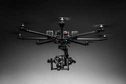 Multicopter closeup on studio background. Drone with professional camera. Octocopter for filming.
