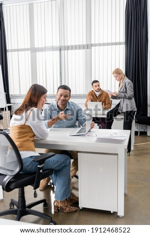 Multicultural business people working with devices in office stock photo