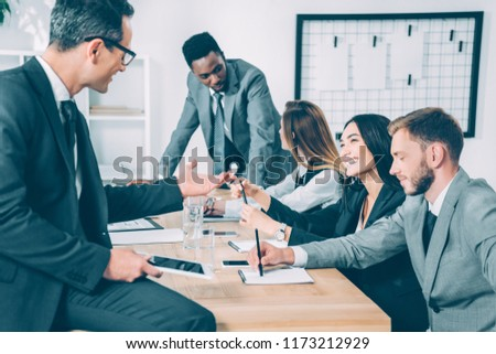 multicultural businesspeople having conversation in conference hall #1173212929