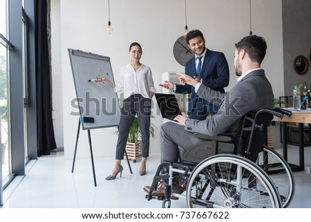 multicultural businesspeople working on new project together in office #737667622