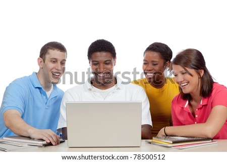 Multicultural College students/friends, male and female, gathered around a computer