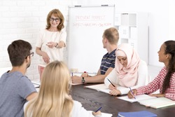 Multicultural language class and positive mature teacher