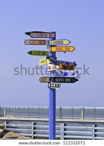 Multidirectional sign for tourists in Egg Harbor, Wisconsin