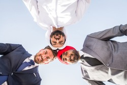 Multiethnic business team meeting outdoors - Three businessmen talking about business on a formal meeting