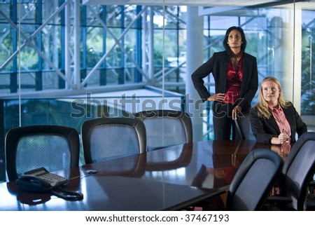 Multiethnic businesswomen in sitting at a boardroom table