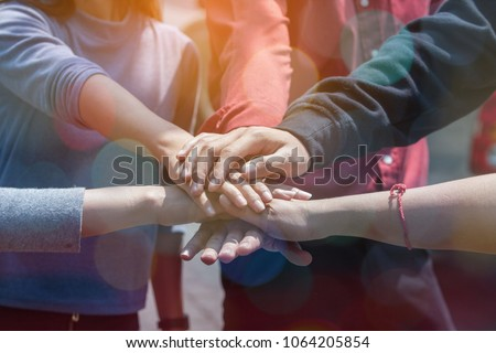 Multiethnic Ethnic Business People or Politicians Putting Hand Harmonious Friendship Together,Hand of Diversity People Volunteer Community Service.StartUp Business Partner Teamwork Together concept.