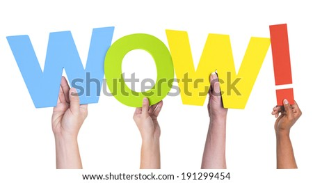 Multiethnic Hands Holding Text Wow with Exclamation Point - stock photo