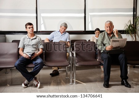 Multiethnic people waiting for the doctor in hospital lobby