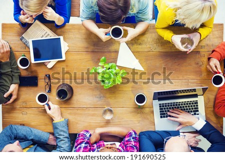 Multiethnic People with Startup Business Talking in a Cafe