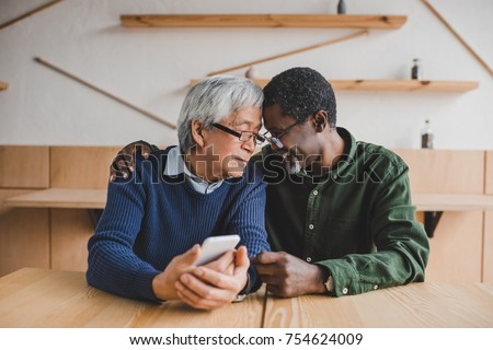 multiethnic senior men embracing while spending time together Stockfoto ©