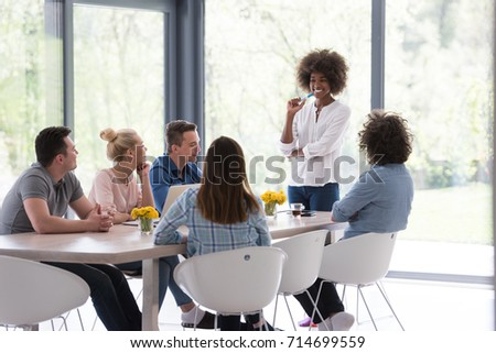 Multiethnic startup business team on meeting in modern bright office interior brainstorming, working on laptop and tablet computer - Shutterstock ID 714699559