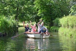 Multigenerational family in rowing boat on river