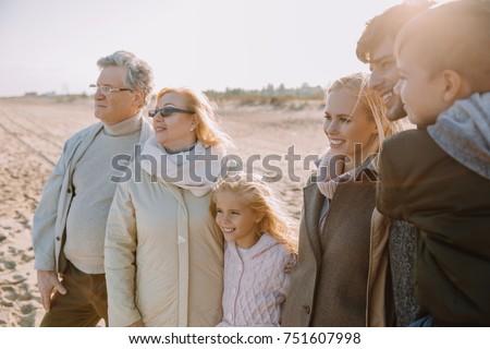 multigenerational family walking together at seaside