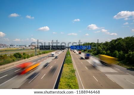 Multilane Autobahn highway with blurred trucks and cars near Frankfurt Airport, Frankfurter Kreuz, Germany