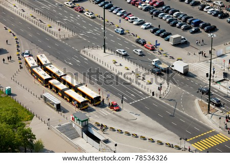 Multilane street, bus depot and parking lot in Warsaw, Poland, view from above