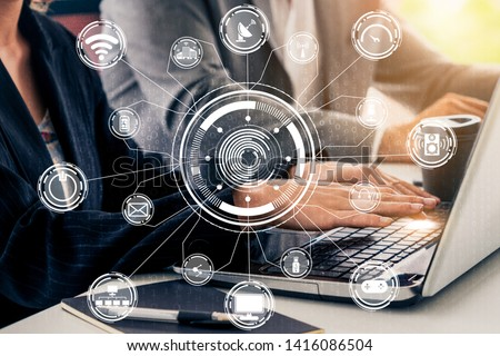 Multimedia and Computer Applications Concept. Business people using technology of digital gadget with modern graphic interface showing social, shopping, camera and multimedia application on device. #1416086504