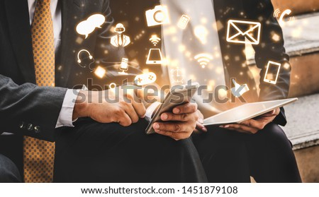 Multimedia and Computer Applications Concept. Business people using technology of digital gadget with modern graphic interface showing social, shopping, camera and multimedia application on device. #1451879108