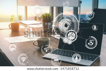 Multimedia and Computer Applications Concept. Business people using technology of digital gadget with modern graphic interface showing social, shopping, camera and multimedia application on device.