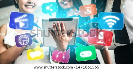 Multimedia and Computer Applications Concept. Business people using technology of digital gadget with modern graphic interface showing social, shopping, camera and multimedia application on device. #1471861565