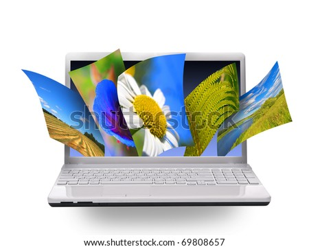 Multimedia concept with notebook. Isolated on white.