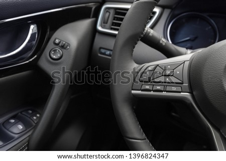 multimedia control panel  on the steering wheel of a modern car #1396824347