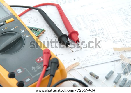 Multimeter lay down the white circuit paper