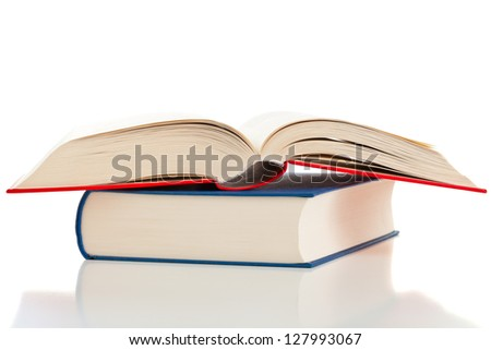 Multiple books with one opened isolated on white background