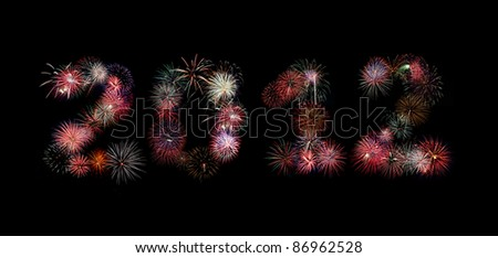 Multiple bursts of colorful fireworks were used to write out the new year 2012