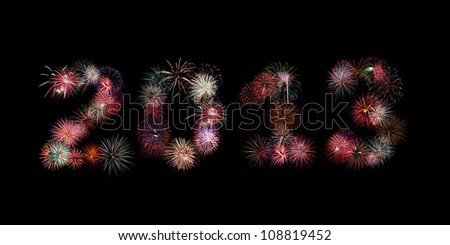 Multiple bursts of colorful fireworks were used to write out the new year 2013 against a black background - stock photo