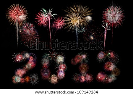 Multiple bursts of colorful fireworks were used to write out the new year 2013 with additional explosions above against a black background