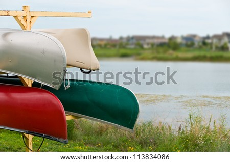 Multiple Canoes By the edge of a Lake
