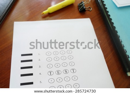 Multiple choice exam paper with Test text