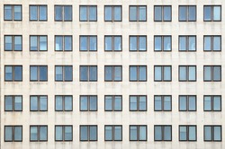 Multiple closed windows on a large office building