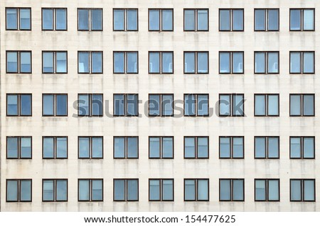 Multiple closed windows on a large office building #154477625