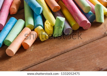 Multiple colorful chalk on wooden floors with copy space #1332052475