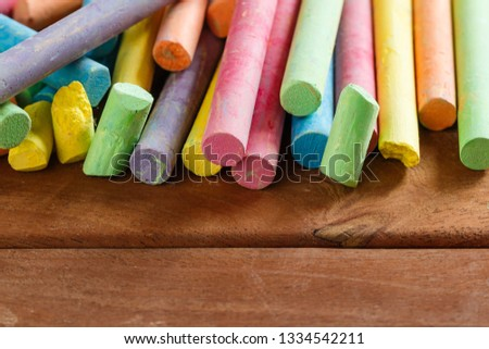 Multiple colorful chalk on wooden floors with copy space #1334542211