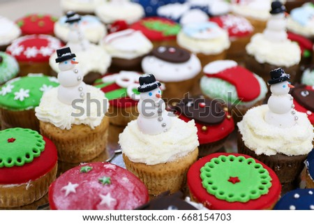 Multiple Colorful Nicely Decorated Party Muffins With Tasty Snowman