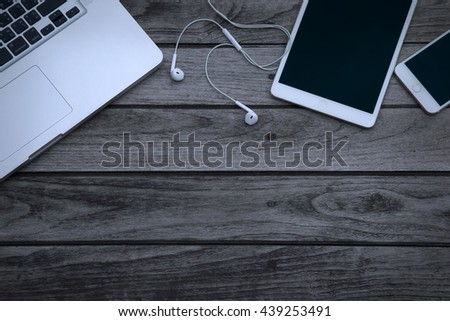 multiple devices phone laptop and tablet on wooden background #439253491
