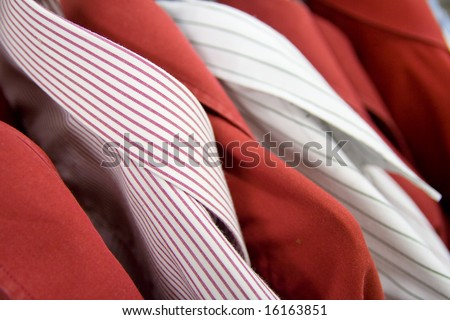 Multiple different shirts hanging. Close up, shallow dof.