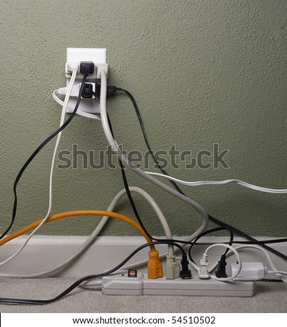 Multiple electrical plugs in wall outlet