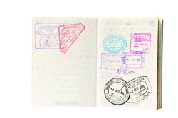 Multiple entries into South East Asia and Australia, resulting in many entry and exit stamps in a Canadian passport. Isolated on white.