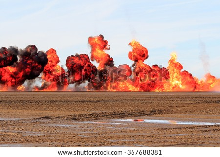 Multiple  explosions on a sandy beach #367688381