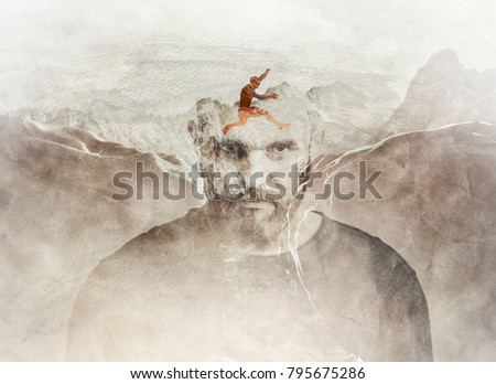 Multiple exposure composition of man jumping between the mountains blended into man's head. Conceptual