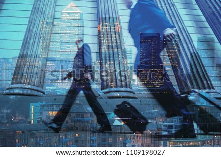 Multiple exposure of city commuters walking with trolleys and skyscrapers of the financial district in London, UK. Concept for management, corporate strategies, future cities, employment, finance #1109198027