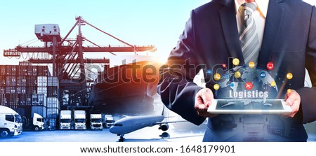 Multiple exposures of Businessman touching tablet for analyze stock at logistics port and world map with logistic network distribution on background, for Concept of fast or instant shipping