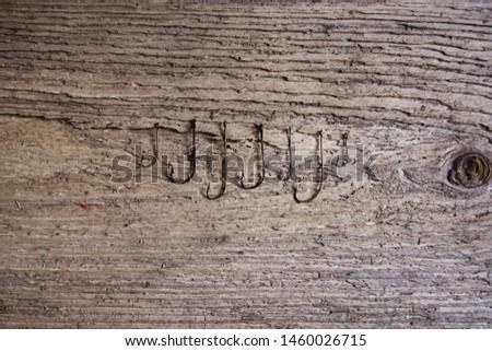 Multiple Fish Hooks on Plank #1460026715